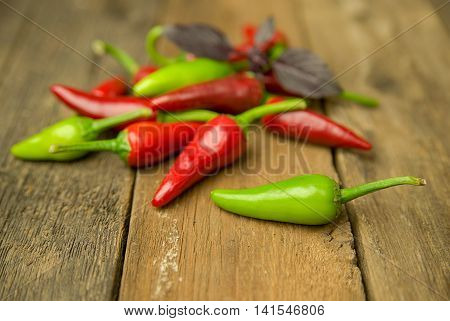 A few Chilli peppers on old wooden surface