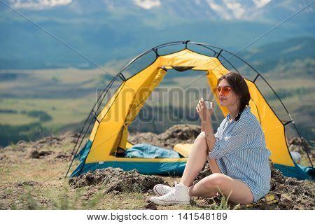beautiful girl drinks tea outdoors coffee thermos