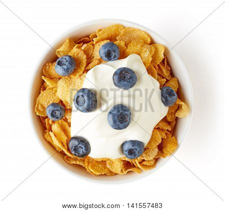 Corn Flakes Bowl With Yogurt And Blueberries Isolated On White, From Above
