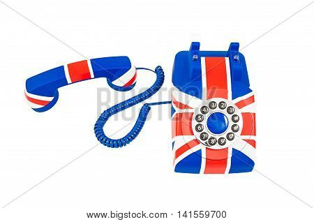 Union Jack telephone with pattern of British flag telephone with the receiver off the hook laying near the phone isolated on the white background. Selective focus at the receiver