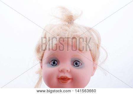 Baby doll's head on a white background