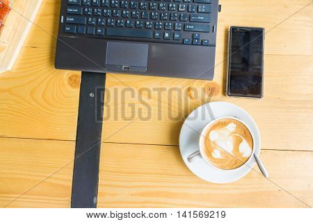 Flat Lay Office Stuff With Smart Phone Laptop Breakfast Sweet And Coffee Cup Top View Shot.