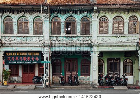 GEORGE TOWN MALAYSIA - MARCH 27: Facade of the old building located in UNESCO Heritage Buffer Zone George Town Penang Malaysia on March 27 2016.