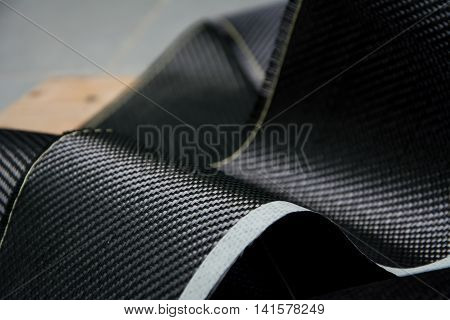 Carbon fiber kevlar composite raw material background