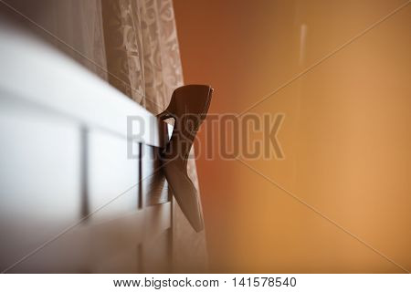 The shoes of a bride on the headboard