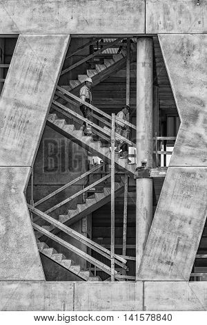 HELSINGBORG SWEDEN - JULY 18 2016: A couple of workers go about their day at the constuction of the new Helsingborg IF main stand at Olympia stadium.