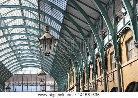 LONDON, UNITED KINGDOM - SEPTEMBER 12 2015: Architectural detail of Covent Garden glazed roof and a lamp London