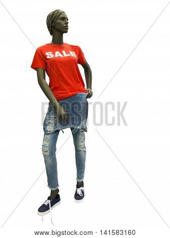 Female mannequin dressed in overalls and red t-shirt on which sale is written. No brand names or copyright objects.