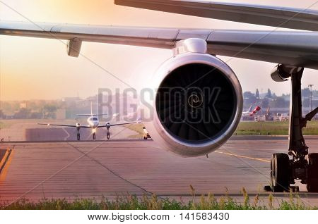 Turbo fan jet engine of a modern airplane at airport
