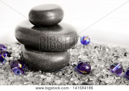 Spa concept - massage stones on white background