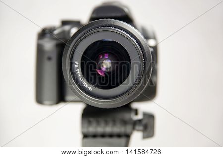 Looking in the eye of a digital camera in photo studio. Lens close up