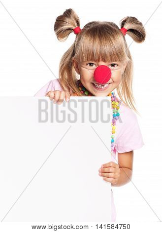 Portrait of happy little girl with red clown nose with white blank, isolated on white background