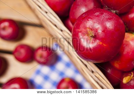 Red apples in a basket on table - top view