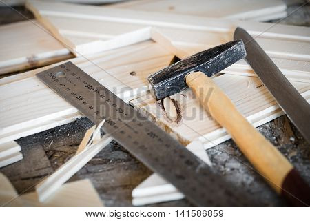 Hammer, Knife, Ruler And Tongue And Groove Boards On Working Place