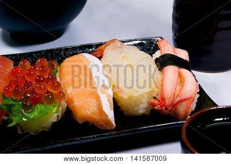 Chromatic Nigiri Sushi,salmon roe,medium fatty tuna,Herring roe.
