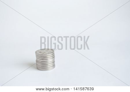 Single stack of U.S. nickels lower left.