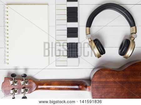 Music Writing Instruments. Music Technology objects on white desk