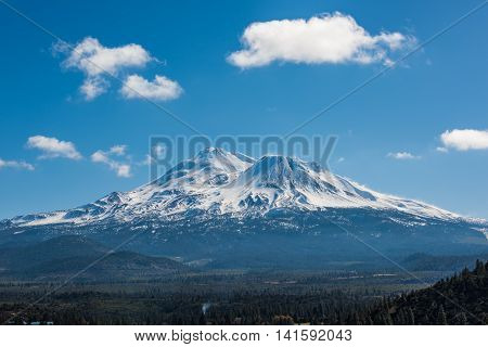 Snowcapped Mount Shasta volcano during winter with valley view