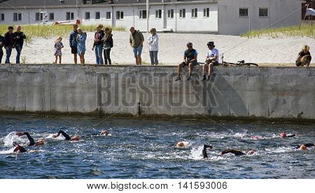 FREDERICIA DENMARK - AUGUST 6 2016: Triathletes swimming in Old Harbor in the triathlon competition Challenge Denmark in Fredericia August 6 2016.
