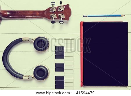 Portable Music instruments with tablet for song writing