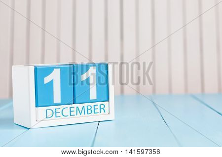 December 11th. Day 11 of month, calendar on wooden background. Winter concept. Empty space for text.