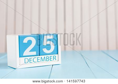 December 25th Eve Christmas. Day 25 of month, calendar on wooden background. New year concept. Empty space for text.