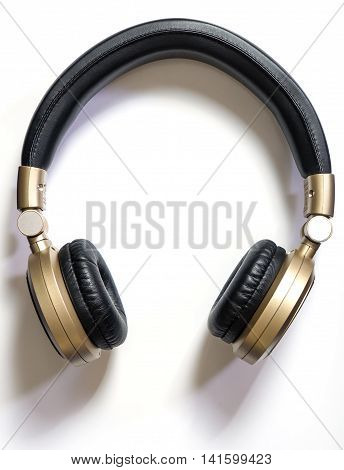 Golden Wireless Audio Hifi headphone isolated on white with shadow
