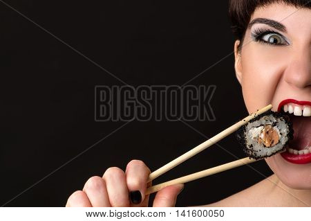 attractive woman with emotional face eating roll