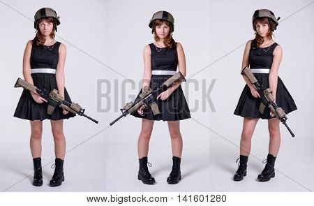 Young pretty girl in black dress and helmet with gun posing on white background.Collage