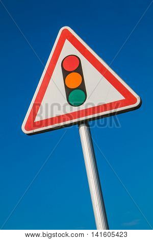 Warning Sign With A Picture Of A Traffic Signal
