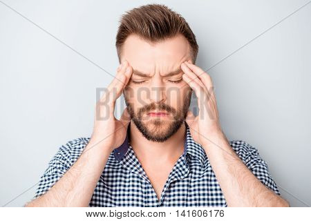 Handsome Young Man Touching His Head And Feeling Strong Headache