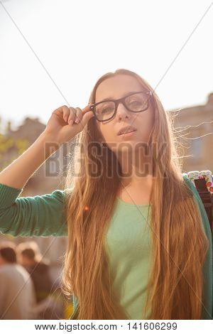 Portrait Of Young Beautiful Woman In Glasses Having Walk In The City