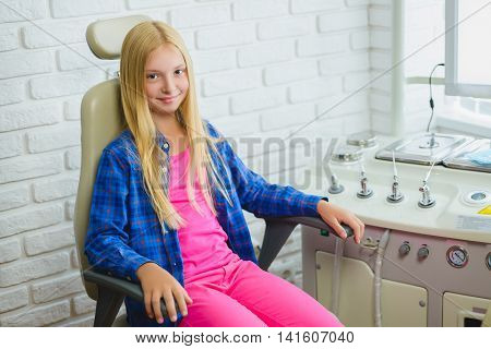 Smiling girl in Otolaryngologist cabinet at clinic.