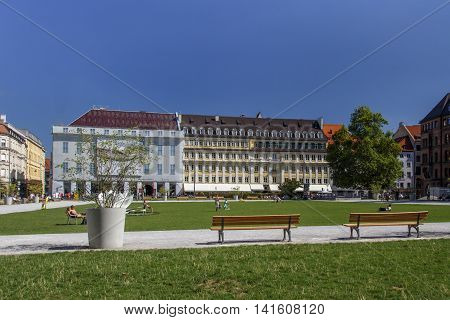 MUNICH, GERMANY - AUGUST 29, 2015: The Marienhof in the inner city of Munich with unidentified people walking around and the original store of Alois Dallmayr the large delicatessen house in Europe
