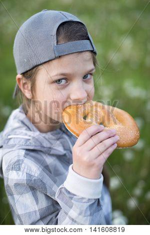 Girl Eating Pretzel