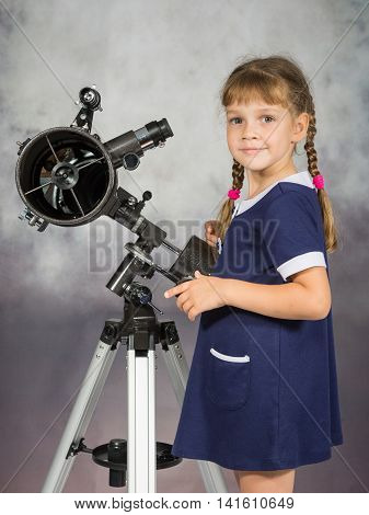 Girl Lover Of Astronomy Stands Next To The Telescope And Looked Into The Frame