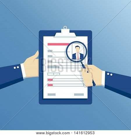 Job interview and recruitment business concept hands holding a resume and see it through a magnifier analysis of questionnaire