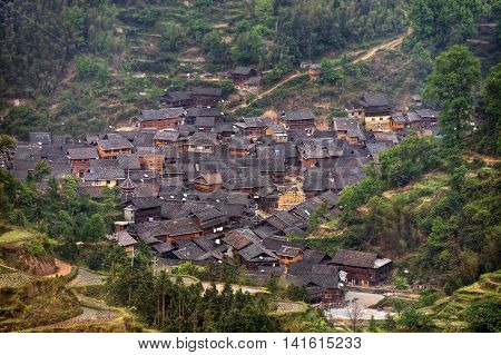 Small hamlet of ethnic minority Dong near the village of Zhaoxing top view daylight cloudy spring Jilun Dong Village Guizhou Province China.
