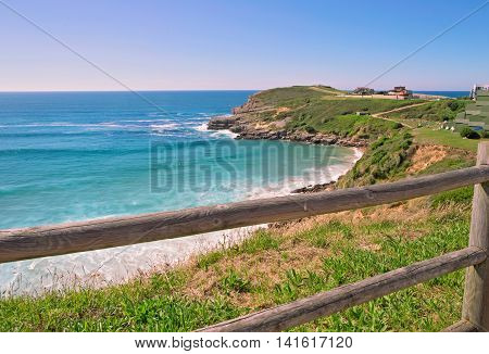 High steep ocean coast in summer day. Spain suburb of Suances summer day in the Province of Cantabria it is photographed from Playa de Los Locos. Toned