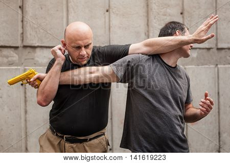 Gun Disarm. Self Defense Techniques Against A Gun Point.