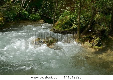 Close-up of rapids of a fast mountain river on the Zlatibor Mountain in Serbia