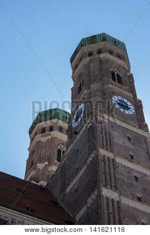 MUNICH, GERMANY - AUGUST 29, 2015: Towers of the Frauenkirche (Cathedral of Our Dear Lady) in Munich the church is located close to Marienplatz