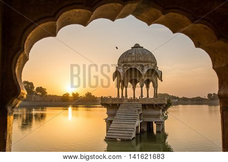 Gadi Sagar - artificial lake view through arch. Jaisalmer, Rajasthan, India