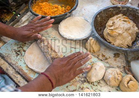 Traditional way of making indian parantha on street sell stall in Jaisalmer, India