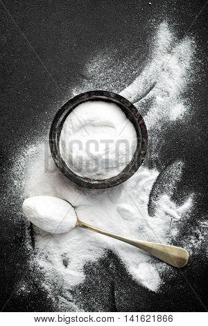 baking soda on dark background, top view