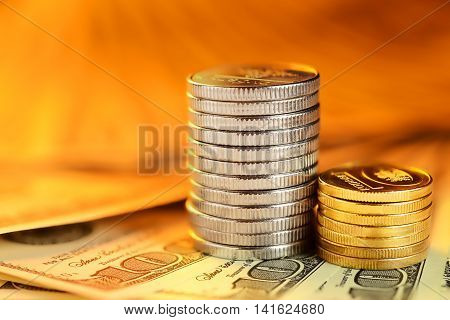Stacks Of Coins And Dollar Bills