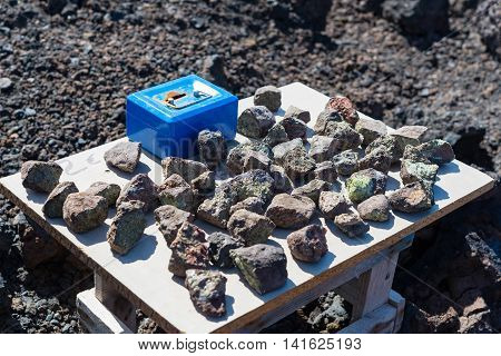 poster of Table stall with blue till box on Canary Island with bizarre-shaped cliffs and underwater caves produced by the solidification of lava and erosion