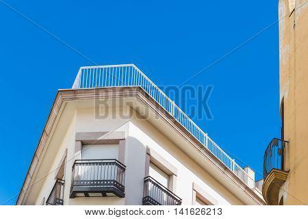 Corner Of Apartment Building Under Blue Sky