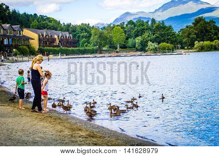 People having fun on a sunny summer day at Loch Lomond lake in Scotland, 21 July 2016