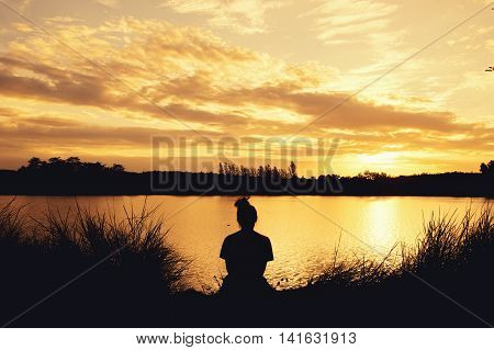 Silhouette of lonely woman waitting for someone come back to her